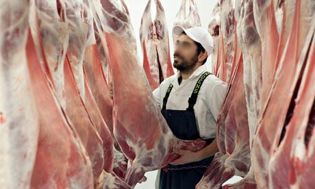 A butcher in an abattoir.