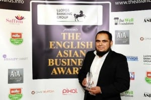 Faruk Vali, managing director of KQF, accepts the Business of the Year award
