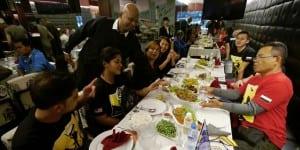 James Segaran serving his customers at the d'Lions Restaurant in Hanoi.