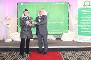 Salama Evans, managing editor HalalFocus being given award by HFA Chairman