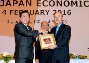Good ties: Ong (left) presenting a memento to Japan Chambers of Commerce and Industry chairman Dr Kio Mimura at the forum in Kuala Lumpur. The Star/ANN