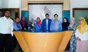 Dr Nur Rahman (4th R), CEO of Ghanim International Corporation, poses for a group photo with Brunei Halal staff members at their new head office in Gadong.